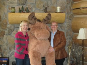 Margie and Lisa Miller with a giant stuffed moose