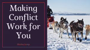 Making Conflict Work for You - Shirley Jump - dogs harnessed to a sled in the snow