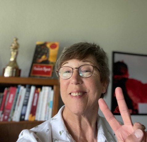 Laura Drake holding up two fingers